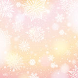 Light pink background with snowflakes and stars Stock Images