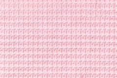 Light pink background from soft fleecy fabric close up. Texture of textiles macro Royalty Free Stock Photography