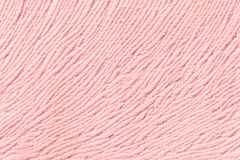 Light pink background from soft textile material. Fabric with natural texture. Stock Images