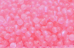 Light pink beads. Background of light pink beads Stock Photos
