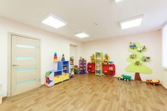 Light pink colored game room in the kindergarten.  Stock Images