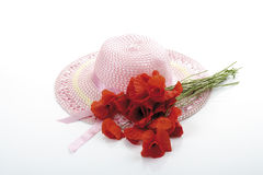 Light pink girlish summer hat and a bunch of poppies Stock Images