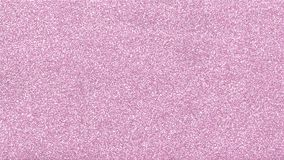 Light pink glittery confetti texture for festival and celebration designs. Light pink glittery blank surface. shining background texture for festival and Stock Images