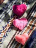 Pink hearts on  Christmas sweater Royalty Free Stock Photography