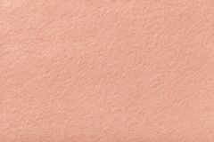 Light pink matt suede fabric closeup. Velvet texture of felt. Light pink matte background of suede fabric, closeup. Velvet texture of seamless coral woolen felt stock images