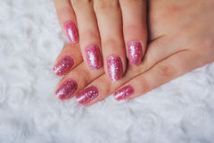 Light pink nail art with tinsel stock photos