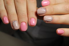 Light pink nails with rhinestones, manicure design royalty free stock photography
