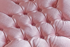 Light pink quilted fabric texture on armchair Stock Photography