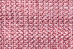 Light pink textile background with checkered pattern, closeup. Structure of the fabric macro. Stock Image
