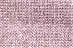 Light pink textile background with checkered pattern, closeup. Structure of the fabric macro. Royalty Free Stock Image