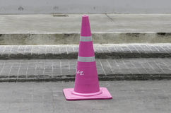 Light pink Traffic cone in the road Stock Image