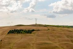 A light pole against a cloudy day at the top of a hill. In a typical tuscan landscape near Siena stock photos