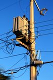 Light pole distribution transformer messy wires Royalty Free Stock Photo