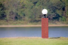 Light pole in green garden Royalty Free Stock Image