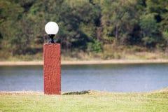 Light pole in green garden Stock Photo