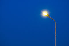 Light pole. A part of top street light pole with dark blue sky background  in twilight time Stock Images