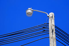 Light Pole with Power Lines and Blue Sky Royalty Free Stock Image