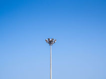 Light pole tower on clear blue sky. Stock Photo