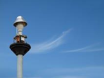 Light pole under the blue sky.  Stock Photos
