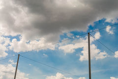 Light pole wires with blue sky white clouds Royalty Free Stock Photography