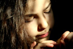 Light. Portrait of a sunbeam on the face of a small woman royalty free stock images