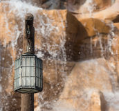 Light post in front of waterfall. Stock Photos