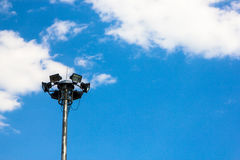 Light post isolated on a blue sky. Background Stock Photography