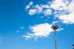Light post isolated on a blue sky. Background Royalty Free Stock Photos