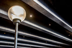 Light post under concrete beams Royalty Free Stock Images