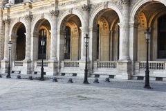 Light Posts, Arches, Louvre, Paris, France. Clear Courtyard and Light Posts, Arches, Louvre, Paris, France Royalty Free Stock Photos