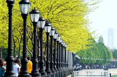 Light Posts in Battery Park, Manhattan, New York. Light posts lined up like soldiers at Battery Park, New York Royalty Free Stock Images