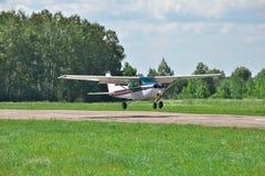 Light private plane landing Stock Photos