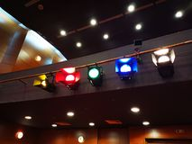 Light projectors with colored filters. In a theater hall and lights control on the ceiling stock photos
