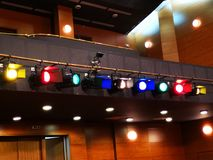Light projectors with colored filters. In a theater hall and wall lights control stock photography