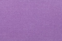 Light purple background from a textile material. Fabric with natural texture. Backdrop. Light purple background from a textile material. Fabric with natural Stock Image