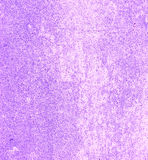 Light Purple concrete wall. Wall concrete with grains and textures painted in lavender purple color royalty free stock images