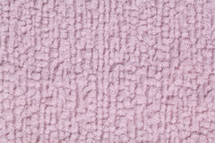 Light purple fluffy background of soft, fleecy cloth. Texture of textile closeup. Royalty Free Stock Photo