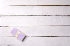 Light purple gift box on painted floor Stock Photo