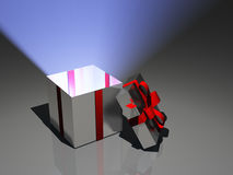 Light radiates from open gift. Box Stock Photo