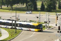 Light Rail 7. A light rail mass transit train crossing an intersection in Bloomington, MN Stock Image