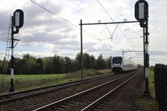 Light rail,commuter,train at railroad track between Gouda and Rotterdam at Moordrecht.  royalty free stock images