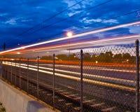 Light Rail Light. Denver Colorado's Municipal Light Rail Speeding southbound on Interstate 25 stock photography