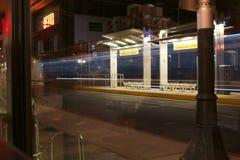 Light Rail Passing. Long exposure of the Tucson Light Rail in down town Tucson Stock Photos