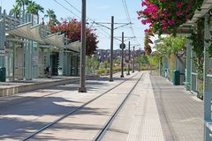 Light rail station with double track and overhead catenary stock image