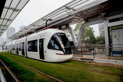 Light rail street car running in the city stock photo