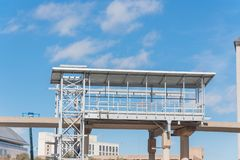 Light rail system station under construction in Las Colinas, Irv. Ing, Texas, USA. Elevated  Area Personal Transit APT automated peoplemover system platform blue Royalty Free Stock Image