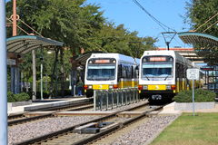 Light Rail Train. Two Dallas Area Rapid Transit (DART) Light Rail Trains loading at the Bush Turnpike Station. The DART Light Rail system contains 85 miles of Stock Photography