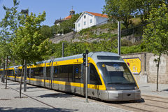 Light rail train of Metro do Porto, Portugal. PORTO, PORTUGAL - JUNE 17, 2013: Light rail train of Metro do Porto, part of the public transport system of Porto Stock Photos