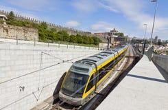 Light rail train of Metro do Porto, Portugal. PORTO, PORTUGAL - JUNE 17, 2013: Light rail train of Metro do Porto, part of the public transport system of Porto Stock Photography