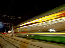 Light rail train at night Royalty Free Stock Images